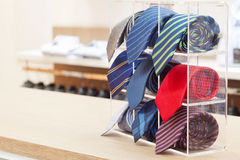 Set of rolled up neck ties on plastic shelf Stock Image