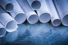 Set of rolled up white construction drawings on Stock Images