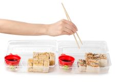 Set of rolls chopsticks for sushi in hand ginger wasabi soy sauce Royalty Free Stock Images