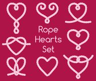 Set of rope hearts decorative knots. On pink background Royalty Free Stock Image
