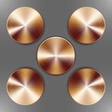 Set of round bronze disks. With brushed metal textures and different angles of reflection isolated on gray background Royalty Free Stock Image