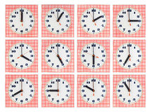 Set of round clockfaces on red striped background Stock Photos