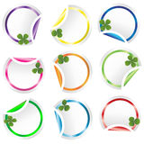 Set of round curled stickers corners with clovers Royalty Free Stock Photography