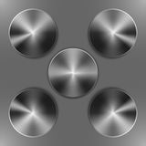 Set of round dark iron disks. With brushed metal textures and different angles of reflection isolated on gray background Stock Photos