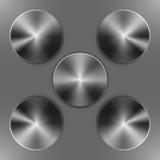 Set of round dark iron disks Stock Photos