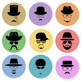 A set of round flat icons. Silhouette of a man wearing a hat, with glasses, with a beard and mustache. Stock Photos