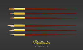Set with round and flat paintbrushes for artists Royalty Free Stock Photography