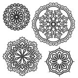 Set of Round floral lace ornaments - black on white background. Royalty Free Stock Photos