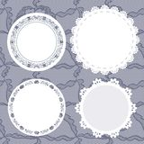 Set of round lacy doilies. Stock Photo