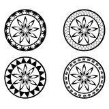 Set of round ornaments. Set of four black and white round ornaments Stock Image