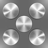 Set of round silver disks. With brushed metal textures and different angles of reflection isolated on gray background Royalty Free Stock Image