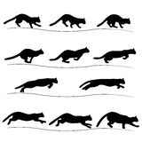 Set of running black cat silhouettes Royalty Free Stock Photos
