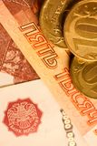Set of russian ruble coins laying on russian banknotes. Russian currency close up Stock Images