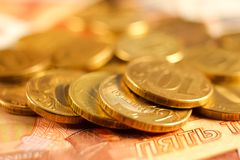 Set of russian ruble coins laying on russian banknotes. Russian currency close up Stock Image