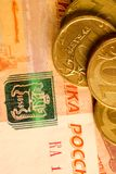 Set of russian ruble coins laying on russian banknotes. Russian currency close up Stock Photo