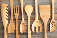 Set of rustic wooden handcrafted kitchen utensils Royalty Free Stock Images