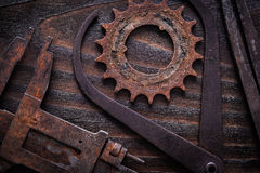 Set of rusty measuring calipers with cog- wheel on vintage dark Royalty Free Stock Photo