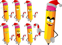 Set of sad pencils holding a candy cane and wearing Santa's hat Royalty Free Stock Images