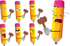 Set of sad pencils with a wooden hammer Royalty Free Stock Photo
