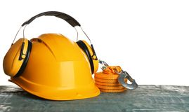Set of safety equipment on table against white. Background royalty free stock images