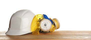 Set of safety equipment on table. Against white background stock image