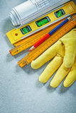 Set of safety gloves construction level wooden meter engineering. Drawings pencil on concrete background building concept Royalty Free Stock Photography