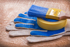 Set of safety gloves with paint brush on duct tape Royalty Free Stock Image