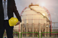 Set of safety work wear on Storage Tank refinery background , image construction concept. Set of safety work wear on Storage Tank refinery background Royalty Free Stock Images
