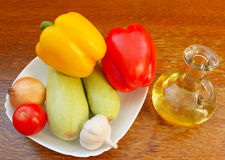 Set of salad and bottle of vegetable oil Royalty Free Stock Photography