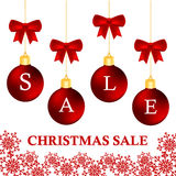 Set of sale and discount christmas balls with red bows. Royalty Free Stock Photos