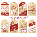Set of sale and discount price tags on kraft paper with handwritten inscriptions Stock Image