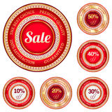 Set of sale labels. Set of labels with inscriptions 10%, 20%, 30%, 40% and 50% discount in red and gold colors royalty free illustration