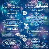 Set of sale labels over blue christmas background Royalty Free Stock Photo