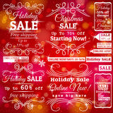 Set of sale labels over red christmas background stock image