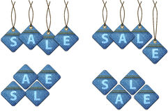 Set of sale shopping labels made of jeans Stock Photos