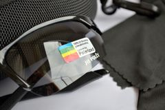 Set for sale of sport black sunglasses with photochromic and polarizing effect, closeup royalty free stock image