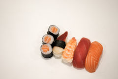 Set of salmon, surf clam, tuna and shrimp sushi, isolated in white background Stock Photo