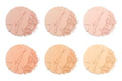 Set of sample of face powder in white. Beige round broken powder palette royalty free stock images