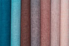 A set of samples of fabric furniture decoration lines of textile textures. Multicolored stripes upholstery. Mode and tone for a luxurious interior style royalty free stock photo