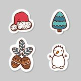 Set of santa cap, snow man, fir tree and nuts. Sticker set for your web design. Xmas holiday. Happy New Year. Set of santa cap, snow man, fir tree and nuts Royalty Free Stock Image