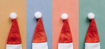 Set of Santa Claus hats on colorful backgrounds. stock image