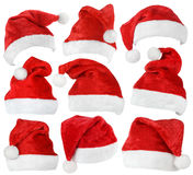Set of Santa Claus red hats. Set of red Santa Claus hats isolated on white background Stock Photography