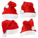 Set of Santa Claus red hats. Set of red Santa Claus hats isolated on white background Royalty Free Stock Image