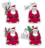 Set of Santa Claus stickers. Santa Claus with reindeer, packbag, Christmas tree and gifts.Holiday Christmas illustration. Set of Santa Claus stickers. Santa Royalty Free Stock Images