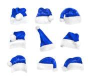 Set Santa ` s kapelusze odizolowywający na bielu z ścinek ścieżką zdjęcia stock