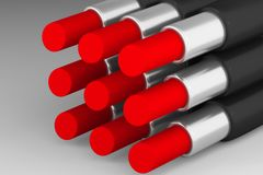 Set of red lipsticks on the light background. Set of saturated red lipsticks on the light background Royalty Free Stock Images