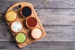 Set of sauces. In bowl on wooden background Royalty Free Stock Photo
