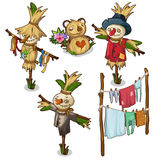 Set of scarecrow, straw toys and drying clothes. Set of funny scarecrow, straw toys and drying clothes. Vector illustration in cartoon style on white background Stock Images