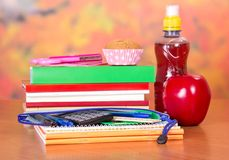 Set of school accessories and bottle with drink Royalty Free Stock Photo
