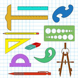 Set of school drawing accessories on cell background Royalty Free Stock Photos